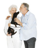 Elderly couple with a dachshund. In a white background Stock Photography