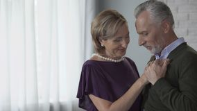 Elderly couple dancing and looking at each other, putting heads together, love. Stock footage stock footage
