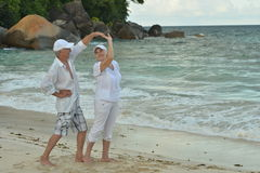 Elderly couple dancing at tropical resort Stock Photography