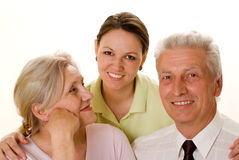 Elderly couple with a daughter Stock Images
