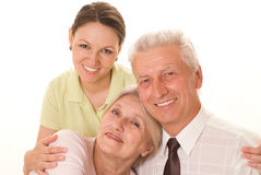 Elderly couple with a daughter Stock Photos