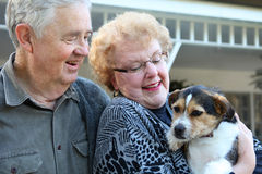 Elderly Couple with Dog Royalty Free Stock Photos