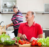 Elderly couple doing chores Royalty Free Stock Photography
