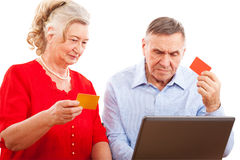 Elderly couple doing online shopping. Royalty Free Stock Image