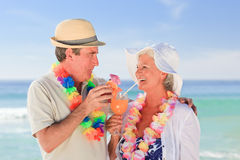 Elderly couple drinking a cocktail Stock Photography
