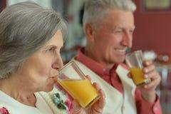 Elderly couple drinking juice Royalty Free Stock Image