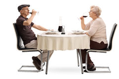 Elderly couple drinking red wine on a date Royalty Free Stock Photos