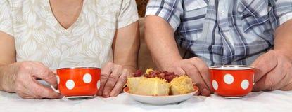 Elderly couple drinking tea Stock Image