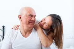 Elderly couple embracing in bed. Stock Photography