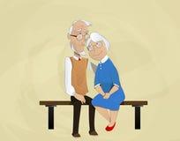Elderly couple embracing sitting on  bench. Royalty Free Stock Photo