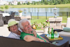Elderly couple enjoy a relaxing day on the patio Stock Image