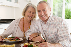 Elderly Couple Enjoying meal,mealtime Together Royalty Free Stock Image