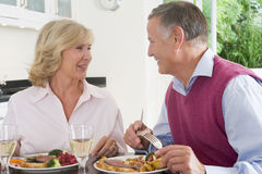 Elderly Couple Enjoying meal, mealtime Together Royalty Free Stock Photography