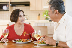 Elderly Couple Enjoying meal, Mealtime Together Royalty Free Stock Photos