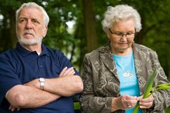 Elderly couple enjoying nature stock photography