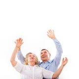 Elderly couple enjoys success stock photos