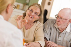 Elderly Couple Explaining Prescription Medicine  Royalty Free Stock Photos