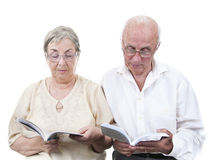 Elderly couple in eyeglasses reading Stock Image