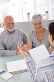 Elderly couple at financial consultation Royalty Free Stock Photos