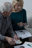 Elderly couple financial problems Stock Photography