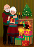 An elderly couple in the fireplace Christmas vector illustration