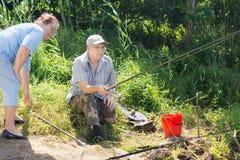Elderly couple fishing together Stock Image
