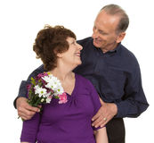 Elderly couple with flowers Royalty Free Stock Images
