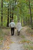 Elderly couple in forest Stock Photography
