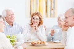 Elderly couple with friendly neighbors Royalty Free Stock Photo