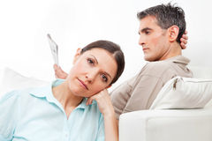 Elderly couple giving the silent. Elderly couple at home giving each other the silent treatment Stock Image