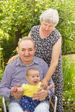 Elderly couple with granddaughter Stock Photos
