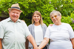 Elderly couple with granddaughter in the park Stock Images