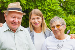 Elderly couple with granddaughter in the park Royalty Free Stock Photography