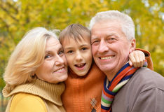 Elderly couple and grandson posing royalty free stock photography
