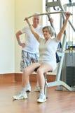 Elderly couple in gym Stock Photos
