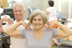 Elderly couple in a gym Stock Image