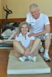 Elderly couple in a gym Stock Photos