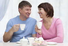 Elderly couple have a breakfast Royalty Free Stock Photos