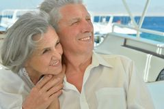 Elderly couple have a ride in a boat Royalty Free Stock Photos