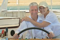 Elderly couple have a ride in a boat Stock Photo