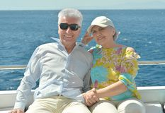 Elderly couple have a ride in a boat Stock Images