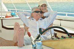 Elderly couple have a ride in a boat Royalty Free Stock Photography