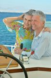 Elderly couple have a ride in a boat Royalty Free Stock Photo