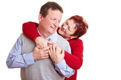 Elderly couple having fun Stock Image