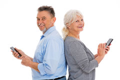 Elderly couple having fun with technology Stock Photos