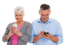 Elderly couple having fun with technology Stock Image