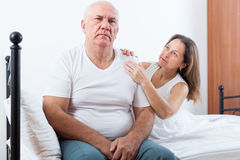 Elderly couple  having problems  in   bedroom. Royalty Free Stock Photo