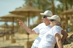 Elderly couple having rest on beach Stock Photography