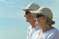 Elderly couple having rest on beach Royalty Free Stock Photos