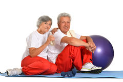 Elderly couple having rest of gym Royalty Free Stock Photography